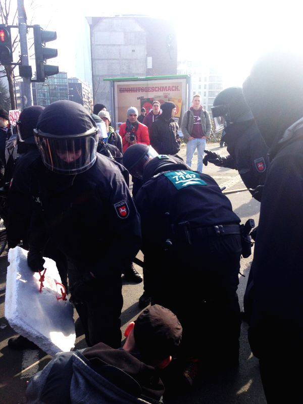 Riot police arrest protestors near the new office building of the European Central Bank in Frankfurt, Germany, March 18, 2015. Protestors clashed with riot ...
