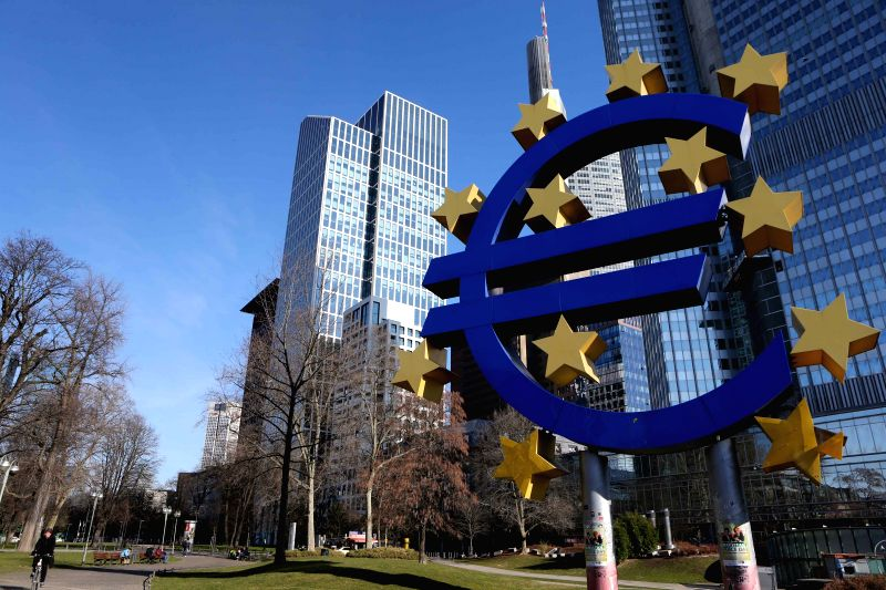 The Euro Logo is seen in front of former headquarters of the European Central Bank (ECB) in Frankfurt, Germany, on March 9, 2015. The bond buying program of the ...