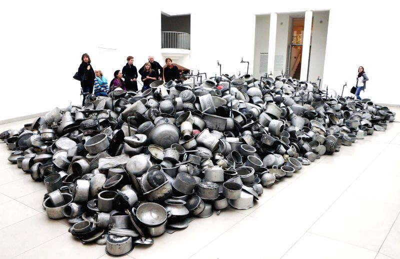 "Visitors admire art works at the exhibition ""Everything is Inside"" of the Indian artist Subodh Gupta at the Museum for Modern Art in Frankfurt, Germany, on Nov. 19, 2014. The ..."