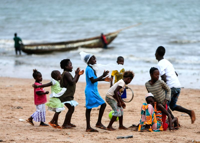 Children play on the beach nearby a ferry port linking the Lungi International Airport and the downtown of Freetown, capital of Sierra Leone, on Aug. 14, 2014. As .