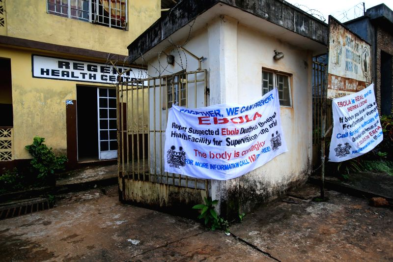 Photo taken on Aug. 16, 2014 shows control and prevention information of the Ebola epidemic outbreak near a community health center in the Ebola-affected Freetown,