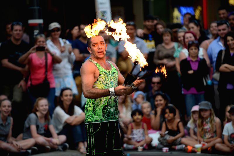 A man performs on the street of Fremantle, Australia, on April 20, 2014. Fremantle Street Art Festival is held in the Western Australian port city of Fremantle ..