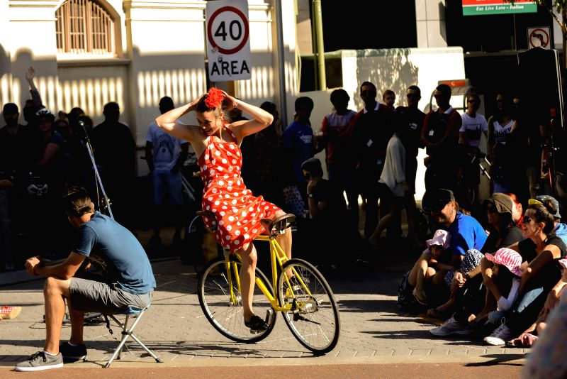 A performer of Switzerland performs acrobatics on bicycle in Fremantle, Australia, on April 21, 2014. Fremantle Street Art Festival is held in the Western ...