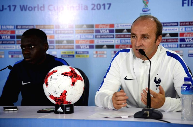 French coach Lionel Rouxel along with the team's captain Claudio Gomes during a press conference ahead of FIFA U-17 World Cup 2017 at Indira Gandhi Athletic Stadium in Guwahati on Oct 7, ... - Claudio Gomes