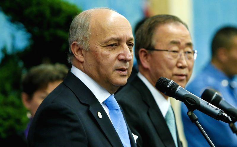 French Foreign Minister and President of Paris Climate Conference Laurent Fabius (L) and UN Secretary-General Ban Ki-moon make a statement during Paris Climate Change ...