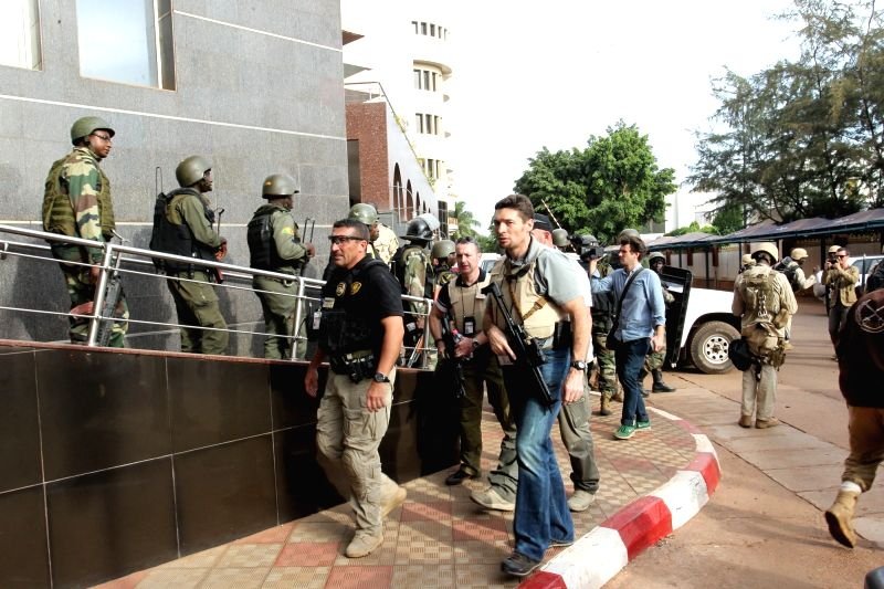 French military personnels are seen outside Radisson Blu hotel in Bamako, Mali, Nov. 20, 2015. Three Chinese citizens were killed in a hostage-taking situation at ...