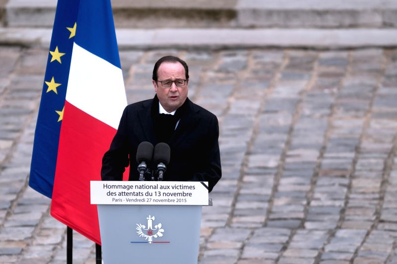 French President Francois Hollande presides over a ceremony to pay tribute to the 130 people killed during the Nov. 13 terrorist attacks at the military museum Les ...