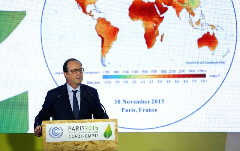 French President Francois Hollande speaks during the launching ceremony of the International Solar Alliance during the 2015 United Nations Climate Change Conference ...