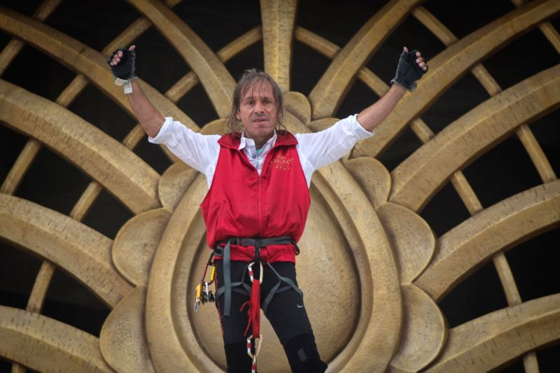 "French ""Spiderman"" Alain Robert after climbing Galaxy Macau hotel using safety harness in Macau of China on April 23, 2014."