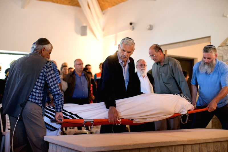 Friends and family members attend the funeral of Rabbi Yaakov Don in Kfar Etzion in the West Bank, on Nov. 20, 2015. Rabbi Don was killed in a shooting attack in ...