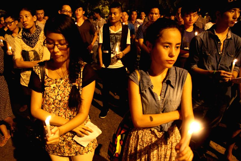 Friends and relatives of 29-year-old Akha Salouni who hailed from North Eastern State of Manipur and was was beaten to death in the national capital, hold a candlelight vigil at Jantar Mantar in New .