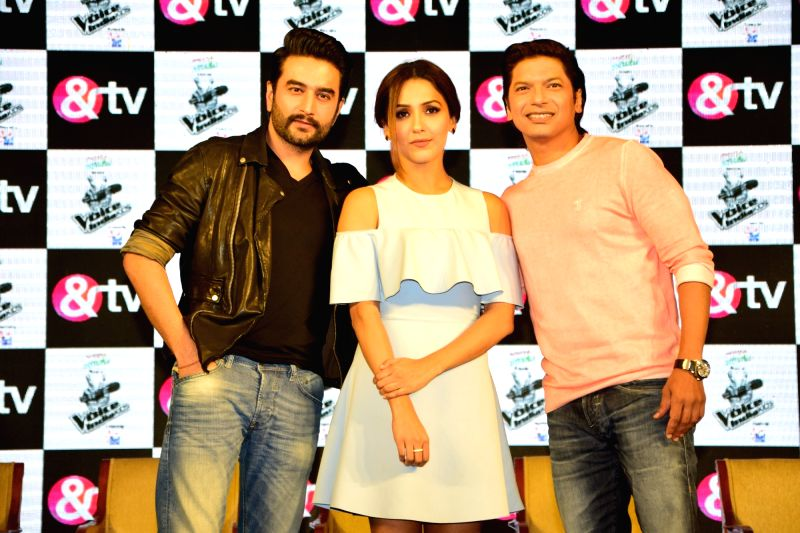 (From L-R) Music composer Shekhar Ravjiani, singers Neeti Mohan and Shaan during the launch of &TV channel The Voice India Kids show, in Mumbai on July 19, 2016.
