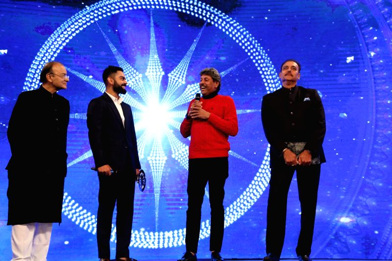 (From L-R) Union Finance Minister Arun Jaitley, Indian cricket team captain Virat Kohli, former India captain Kapil Dev and Indian cricket team coach Ravi Shastri during Indian of the Year ... - Arun Jaitley, Virat Kohli and Kapil Dev