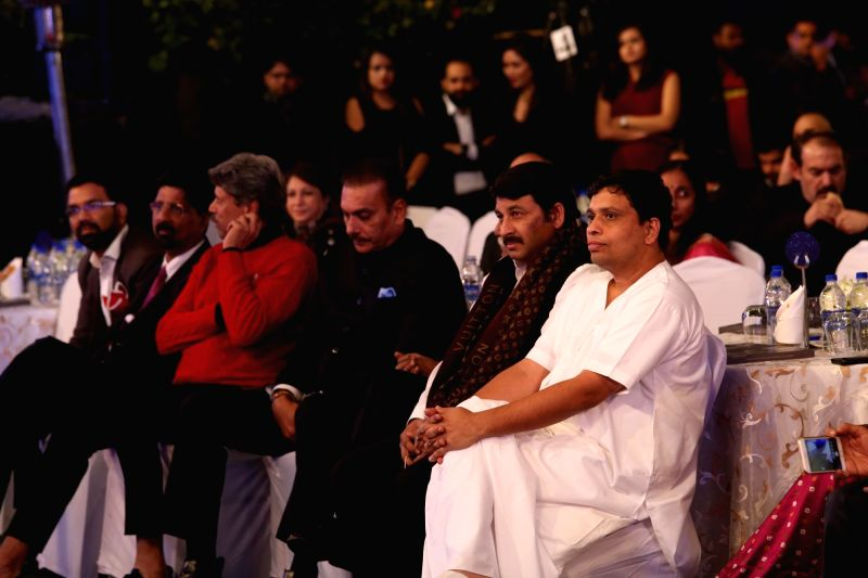 (From R-L) Acharya Balkrishna, of Patanjali, Politician Manoj Tiwari, Indian cricket team coach Ravi Shastri, former India captain Kapil Dev and former Indian cricketer Krishnamachari ... - Kapil Dev