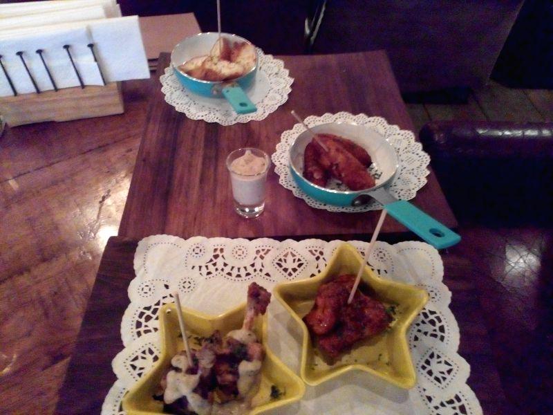 (From top) dahi ke sholey, ham croquetas, chicken wings, charcoal grilled chicken lollipops