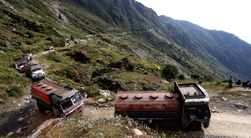 Fuel tankers of Nepal Oil Corporation (NOC) head to Chinese city Kerung to receive the petrol assisted by Chinese government in Rasuwa, Nepal, Oct. 30, 2015. Nepal ...