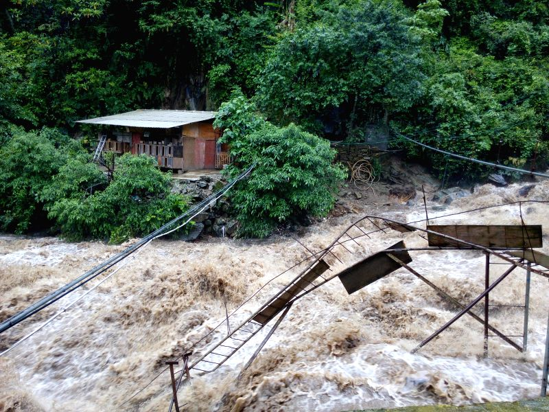 Photo taken on May 10, 2014 shows the torrents of a river in Shangpa township, Fugong county, southwest China's Yunnan Province. Mountain torrents damaged 14 houses ..