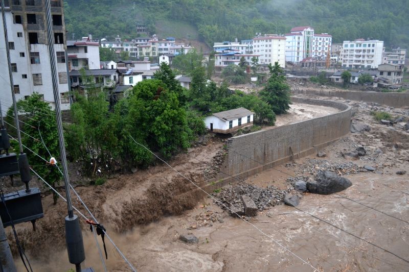 Photo taken on May 10, 2014 shows the torrents in Shangpa township, Fugong county, southwest China's Yunnan Province. Mountain torrents damaged 14 houses and severed .