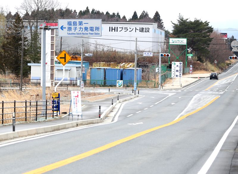 The sign of Fukushima Daiichi nuclear power plant is seen in the district of Okuma, Fukushima Prefecture, Japan, March 7, 2015. The scenes from the towns and ...