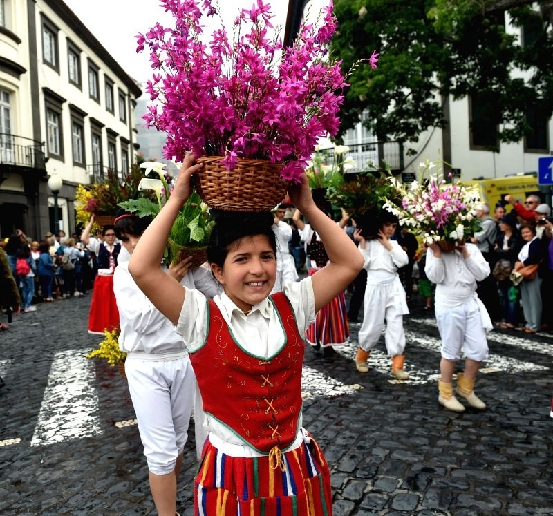 "FUNCHAL(PORTUGAL), May 7, 2017 Children attend a parade towards the ""Wall of Hope"" during the Madeira Flower Festival in Funchal, capital of Madeira Autonomous Region, Portugal, ..."