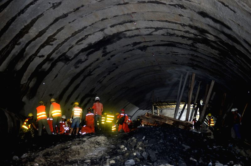 Rescuers work at the site of railway tunnel collapse in Funing County of Zhuang and Miao Autonomous Prefecture of Wenshan, southwest China's Yunnan Province, July ...