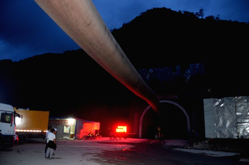 FUNING(YUNNAN), July 15, 2014 Rescuers are seen near a collapsed railway tunnel in Funing, southwest China's Yunnan Province, July 15, 2014. Rescuers were working all out Monday night ...