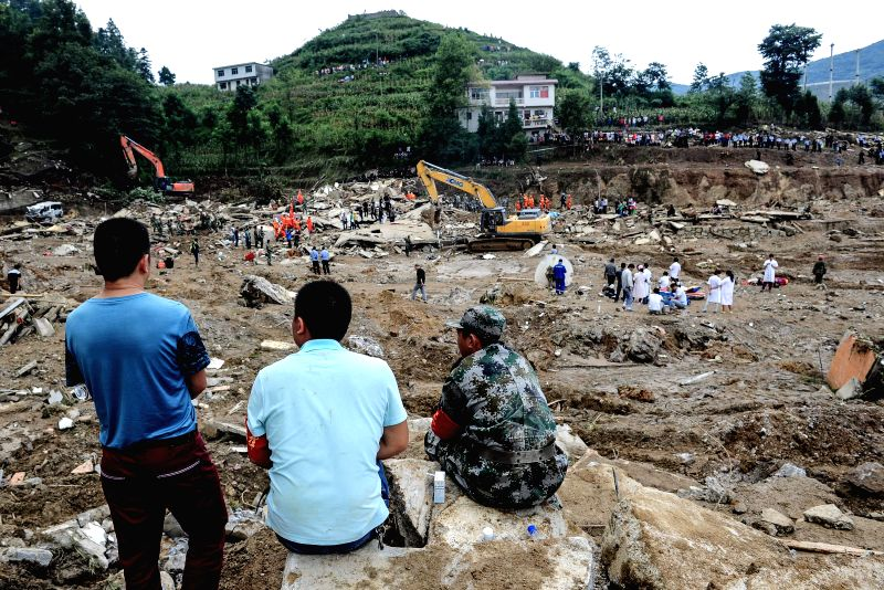 Rescuers work at the site of landslide in Yingping Village of Fuquan City, southwest China's Guizhou Province, Aug. 29, 2014. The death toll has climbed to 15 with ..
