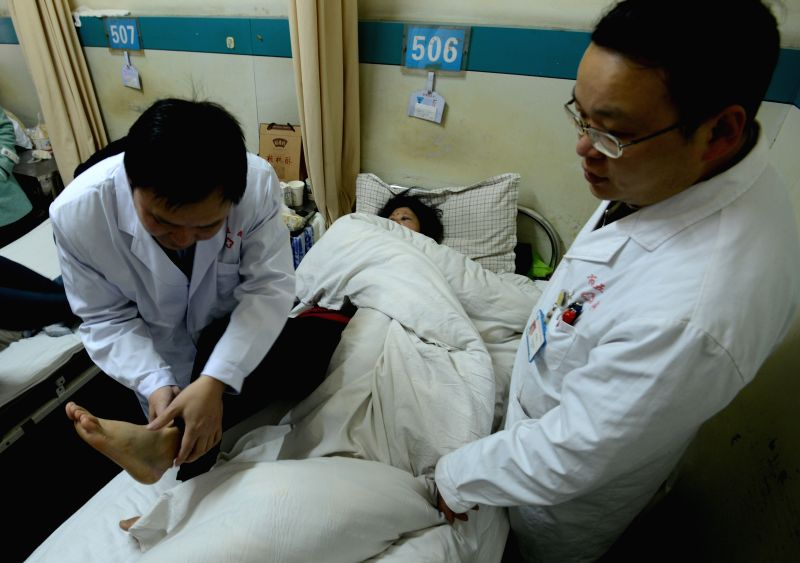 A wounded woman receives treatment in a hospital in Fuyang, east China's Anhui Province, March 15, 2015. Two people have been killed, another 13 injured as of 9 ...