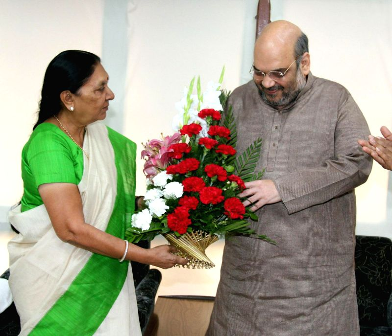 BJP chief Amit Shah calls on Gujarat Chief Minister Anandiben Patel in Gandhinagar, on March 16, 2015. - Anandiben Patel