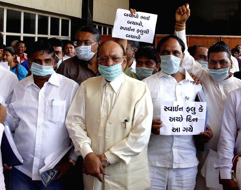 Congress legislators of Gujarat wear masks as a protective measure against swine flu at the Gujarat Assembly in Gandhinagar on Feb 23, 2015.