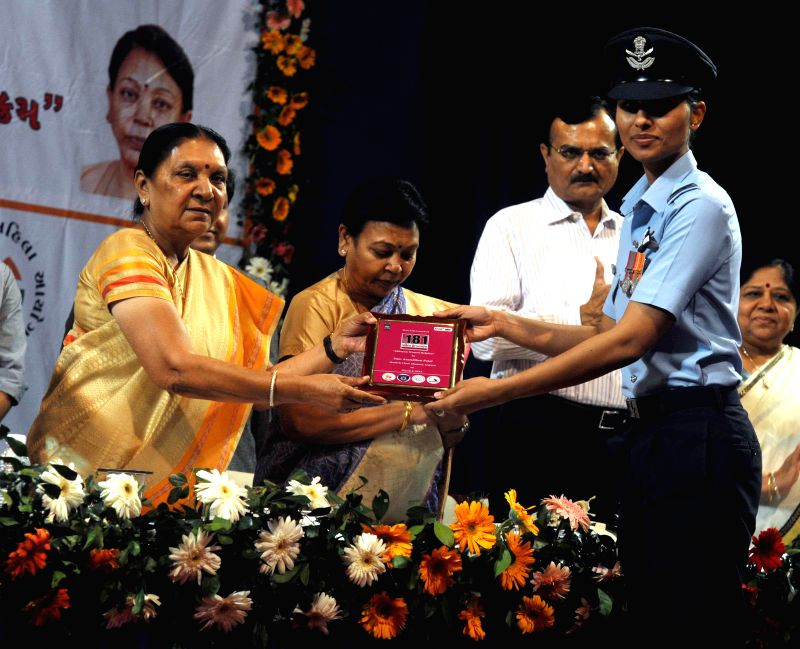 Gujarat Chief Minister Anandiben Patel felicitates squadron leader Sneha Sekhavat during a programme organised on International Women's Day in Gandhinagar, on March 8, 2015. - Anandiben Patel