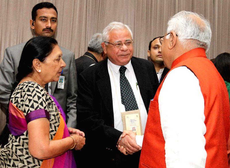 Haryana Chief Minister Manohar Lal Khattar meets NRI from Australia Paras Ram Punj at the CMs Session of the Pravasi Bharatiya Divas 2015, in Gandhinagar, Gujarat on Jan 9, 2015. Also ... - Manohar Lal Khattar and Anandiben Patel