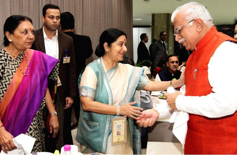 Haryana Chief Minister Manohar Lal Khattar, External Affairs Minister Sushma Swaraj and Gujarat Chief Minister Anandiben Patel at the CMs Session of the Pravasi Bharatiya Divas 2015, in . - Manohar Lal Khattar, Sushma Swaraj and Anandiben Patel