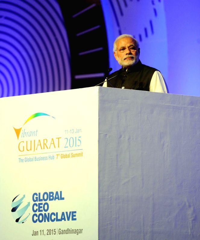 Prime Minister Narendra Modi addresses at the global CEO conclave, in Gandhinagar, Gujarat on Jan 11, 2015. - Narendra Modi