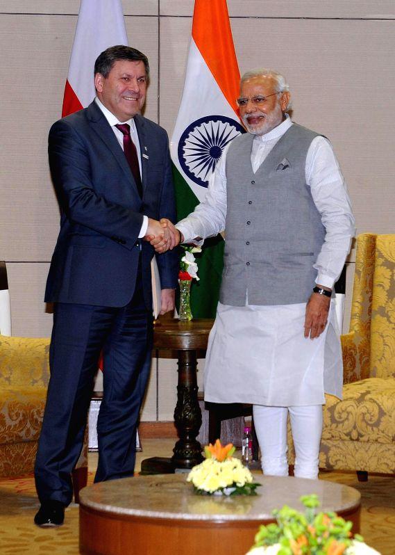Prime Minister Narendra Modi meets Poland Deputy Prime Minister Janusz Piechocinski at New Sachivalaya, in Gandhinagar, Gujarat on Jan 10, 2015. - Narendra Modi