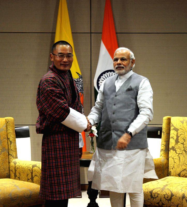 Prime Minister Narendra Modi meets Bhutan Prime Minister Tshering Tobgay at New Sachivalaya, in Gandhinagar, Gujarat on Jan 10, 2015. - Narendra Modi