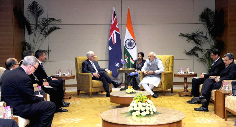 Prime Minister Narendra Modi meets with Australian delegation lead by Andrew Robb, at New Sachivalaya, in Gandhinagar, Gujarat on Jan 10, 2015. - Narendra Modi