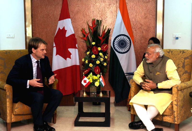 Prime Minister Narendra Modi meets the Minister for citizenship and Immigration of Canada Chris Alexander, in Gandhinagar, Gujarat on Jan 11, 2015. - Narendra Modi