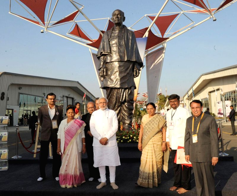 "Prime Minister Narendra Modi with the Gujarat Chief Minister Anandiben Patel at ""Vibrant Gujarat"" Global Trade Show, Exhibition Venue, in Gandhinagar, Gujarat on Jan 8, 2015. - Narendra Modi and Anandiben Patel"