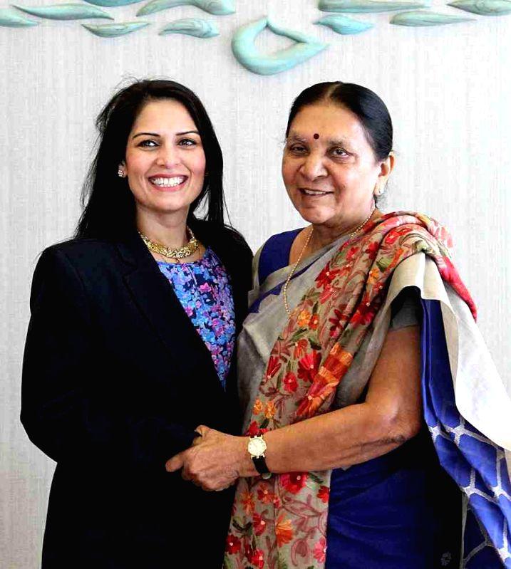 UK MP Priti Patel calls on Gujarat Chief Minister Anandiben Patel in Gandhinagar on Jan 7, 2015. - Anandiben Patel and Priti Patel