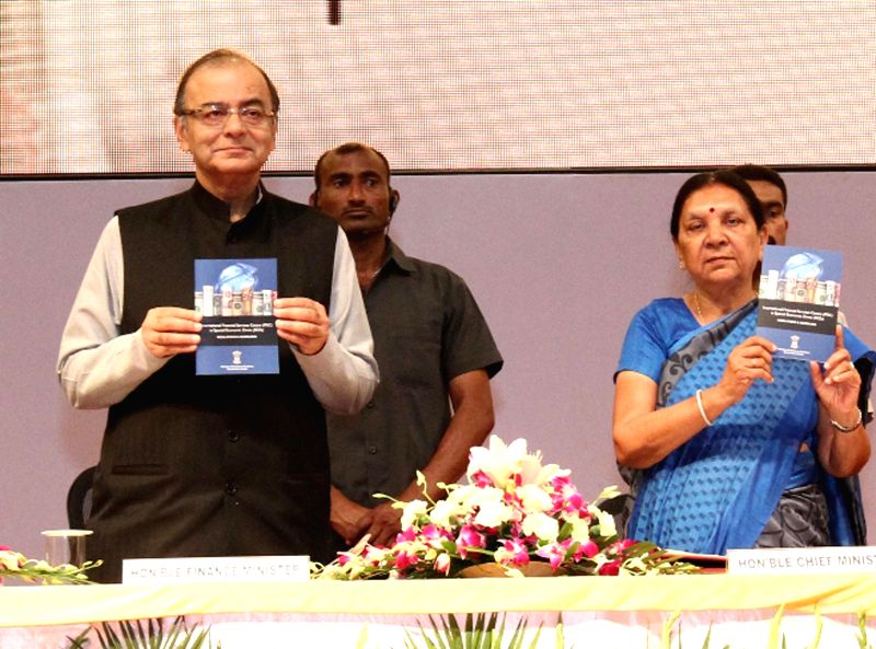 Union Minister for Finance, Corporate Affairs, and Information and Broadcasting Arun Jaitley with Gujarat Chief Minister Anandiben Patel during the inauguration of the International ...
