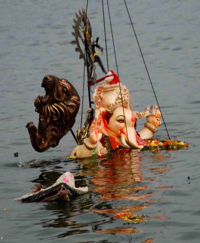 Ganesh idols being removed post Ganesh immersion from the Hussain Sagar lake in Hyderabad on Sept 6, 2017.