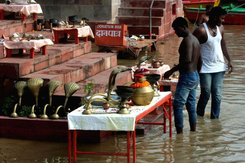 Ganga water inundates Varanasi as water level in rises in the river on Aug 11, 2016.