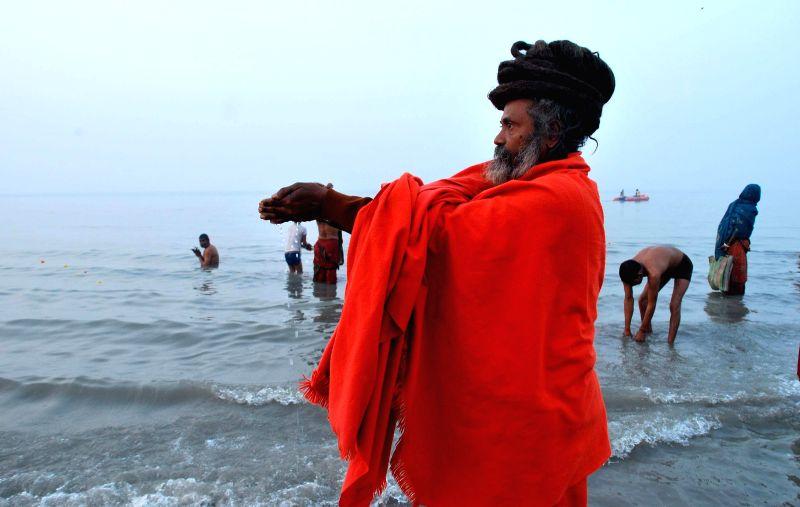 An ascetic performs rituals at the  Gangasagar island, some 160 km south of Kolkata, on `Makar Sankranti` on Jan 14, 2015.