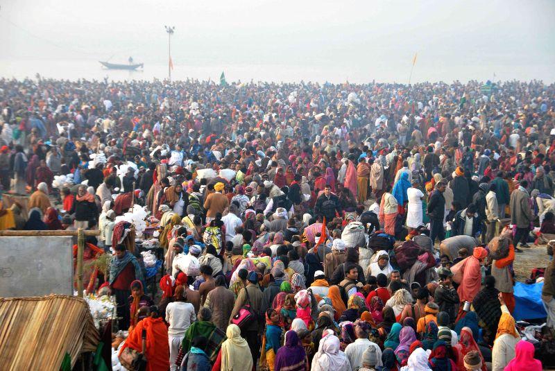 Devotees throng the  Gangasagar island some 160 km south of Kolkata, to take holy dip on `Makar Sankranti`  on Jan 14, 2015.