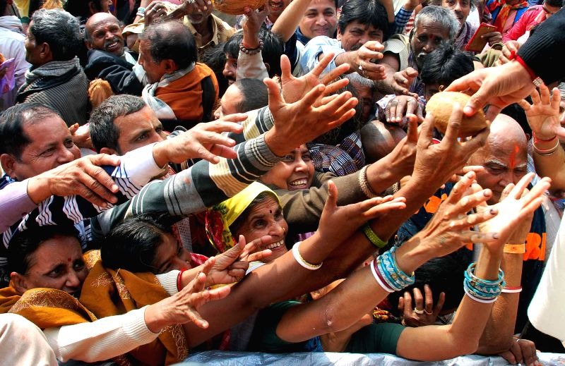 Pilgrims throng Kapilmuni's Ashram after taking a `holy dip` on Makar Sankranti at Gangasagar island some 160 km south of Kolkata on Jan 14, 2015.
