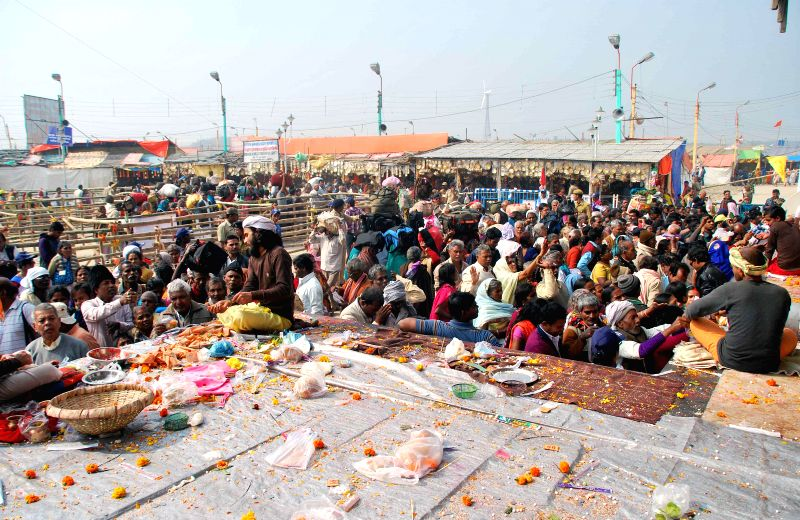 Pilgrims throng Kapilmuni's Ashram after taking a holy dip on Makar Sankranti at Gangasagar island some 160 km south of Kolkata on Jan 14, 2015.