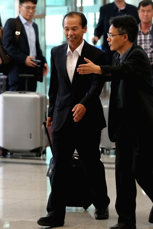 Gangwon Governor Choi Moon-soon enters an immigration office in Paju, north of Seoul, on Aug. 10, 2018, to cross the inter-Korean border and attend an international youth football contest ...