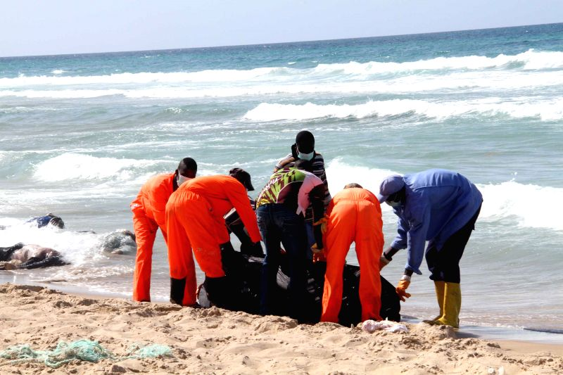 GARABULLI, Aug. 25 Rescue workers transfer a body on the seashore in Garabulli, Libya, on Aug. 25, 2014. Libya's coast guard confirmed on Saturday that a wooden boat carrying some 170 ...