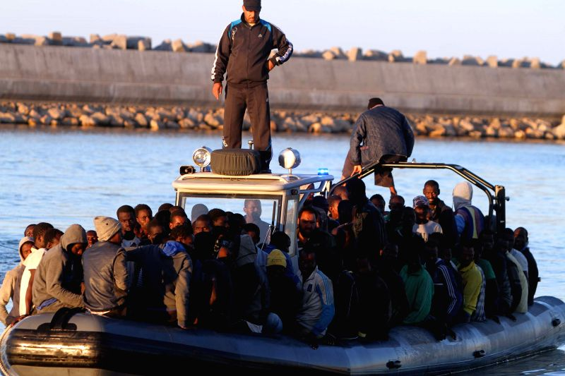 Garabulli (Libya): Some illegal immigrants are on a boat after being rescued in Garabulli, Libya, on Nov. 20, 2014. Libya's coast guard on Thursday rescued dozens of illegal immigrants near the ...